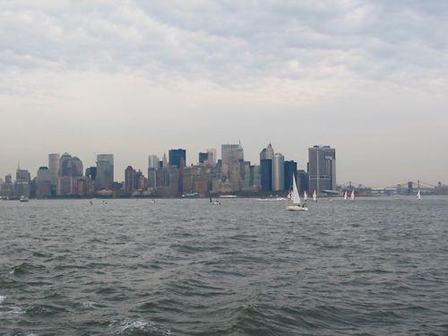 Racing sail boats in bay