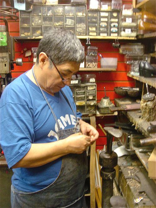 Shoemaker at anvil