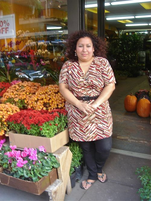 Flower lady in front of shop