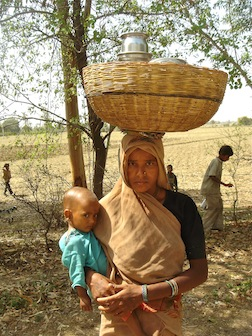India woman with basket & child